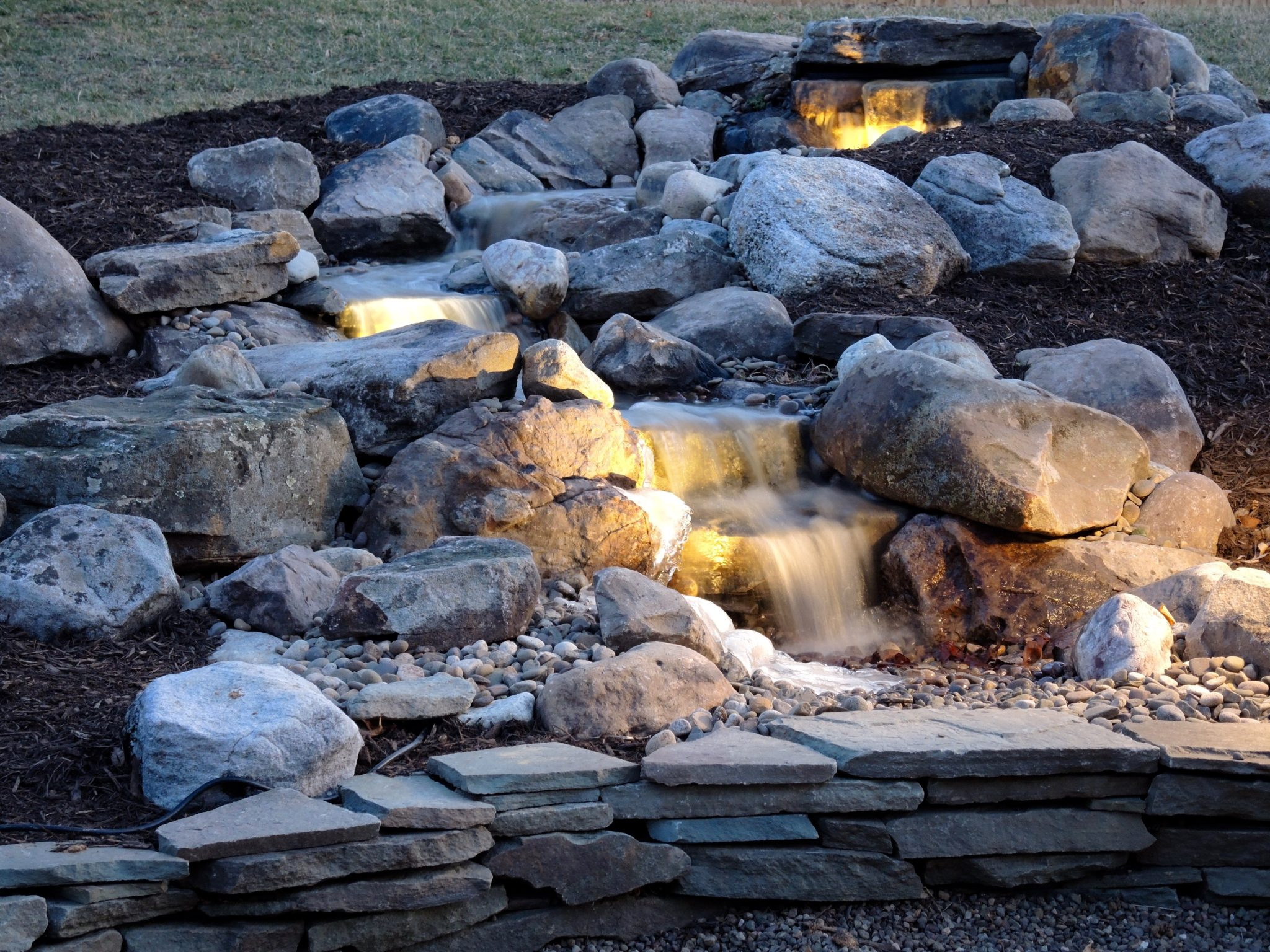 Pondless waterfall installation ponds by bee for Waterfall installation